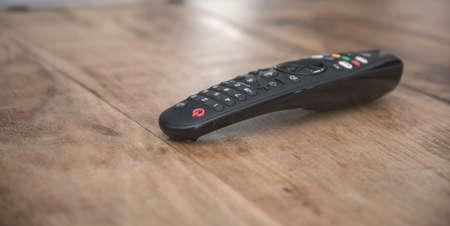 TV remote control on wooden table Standard-Bild