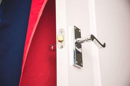Door handle on white door