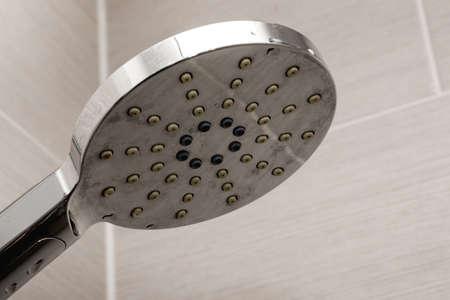 Shower head isolated on cream background. Bathroom shower. Standard-Bild