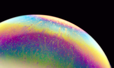 Colourful vibrant background. Psychedelic multicolored patterns background. Photo macro shot of Blurred soap bubbles