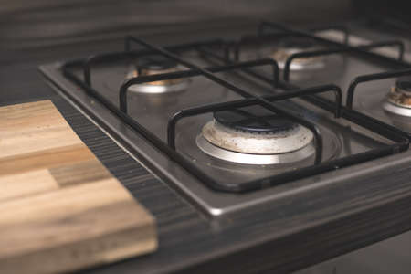 Gas cooker in modern kitchen - cleaning home appliances