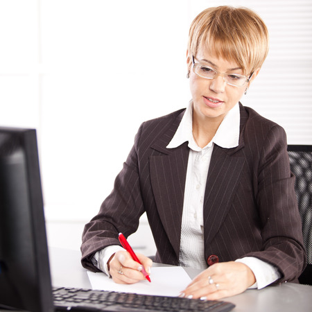 Young businesswoman working at the computer Stock Photo