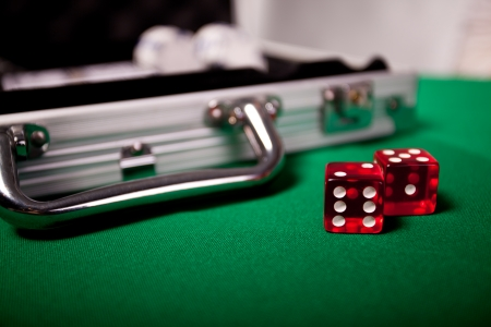 Gambling set, chips, cards and poker table photo