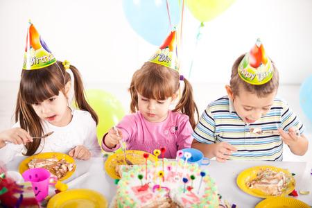 Kids having fun while celebrating birthday photo