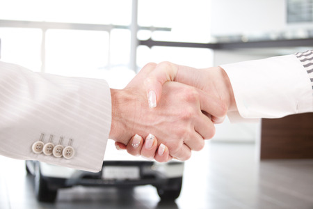 Young businessman in the working environment shaking hands