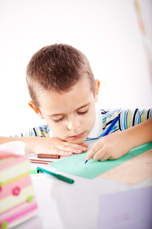 Kid having fun while drawing photo