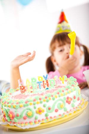 Kid having fun while celebrating birthday