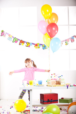 Kid having fun while celebrating birthday photo