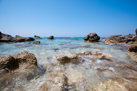Beach and seaside by the rocks Stock Photo