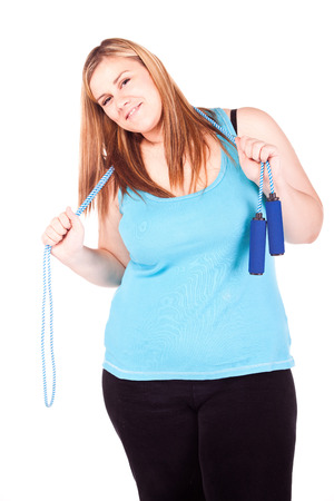 Overweight young girl exercising isolated