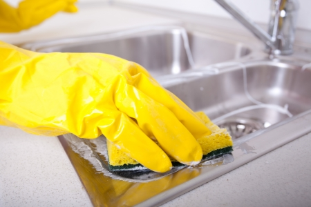 light duty: Cleaning and doing housework Stock Photo