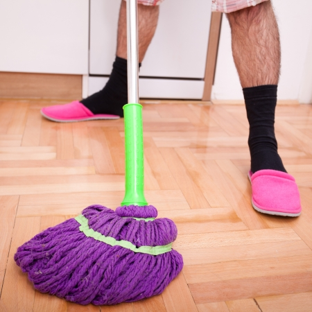 Young man cleaning and doing the housework Stock Photo