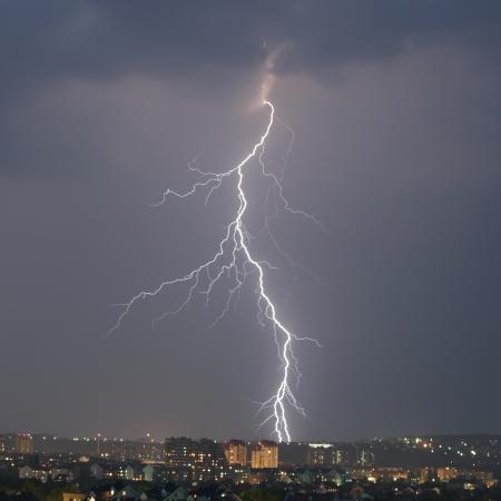Lightning strike over night city photo