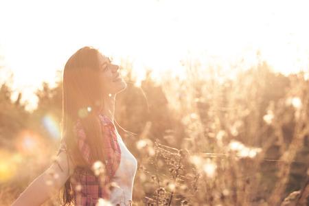Beautiful girl in the open field