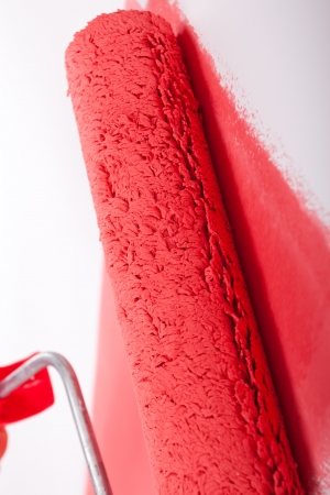 Hand painting wall in red Stock Photo