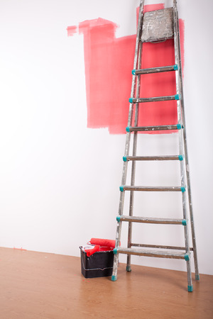 Painting equipment and the white stripe on the wall Stock Photo