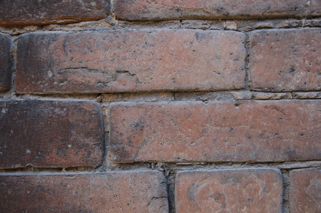 dirty room: Background of old vintage dirty brick wall with peeling plaster, texture. Stock Photo