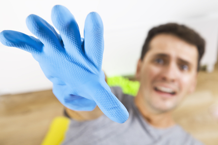 Stressed and screaming young men during cleaning. He has enough housekeeping