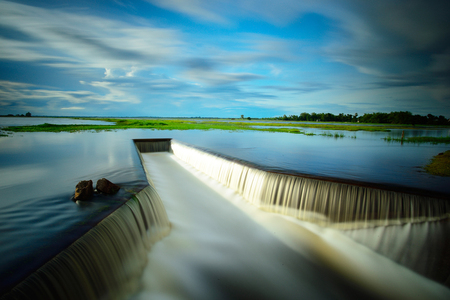 dike: Water flowing from the dam,  Water Gates for Irrigation countryside of Thailand