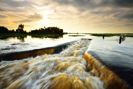 dike: Water flowing from the dam,   Water Gates for Irrigation countryside of Thailand Stock Photo