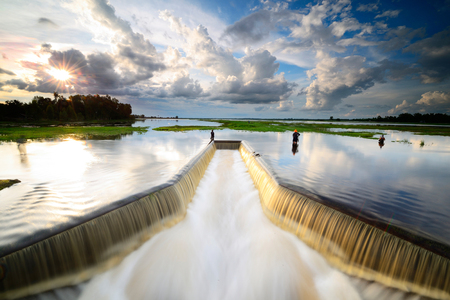 Water flowing from the dam,   Water Gates for Irrigation countryside of Thailand Stock Photo