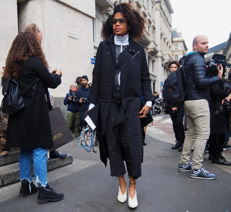 vouge: MILAN - FEBRUARY 26: A Fashionable Girl Walking Before Salvatore Ferragamo Fashion Show, Milan Fashion Week February 26, 2017 in Milan.
