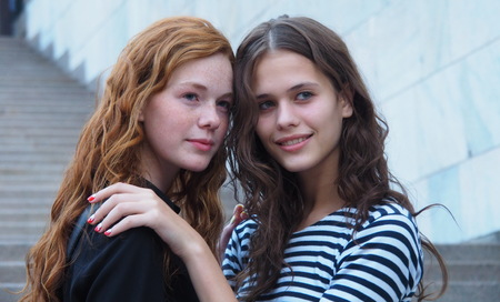 MILAN, ITALY - SEPTEMBER 26, 2015: Two Young Models Posing for Photographers during Milan Fashion Week Woman Fall  Winter 2015.