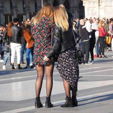Couple in black pantyhose