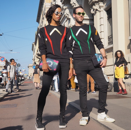 vouge: MILAN, ITALY - SEPTEMBER 24, 2016: Two fashionable men poses for photographers before the CIVIDINI fashion show at Milan Woman Fashion Week street style Spring  Summer 2017