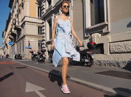 vouge: MILAN, ITALY - SEPTEMBER 24, 2016: Fashionable Wome Walking for Photographers Before the CIVIDINI Fashion Show at Milan Woman Fashion Week street style Spring  Summer 2017. Editorial