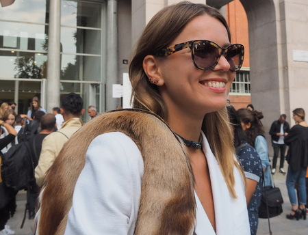 SEPTEMBER 22, 2016: A fashionable girl after EMILIO PUCCI fashion show, Milan Fashion Week Spring  Summer 2017