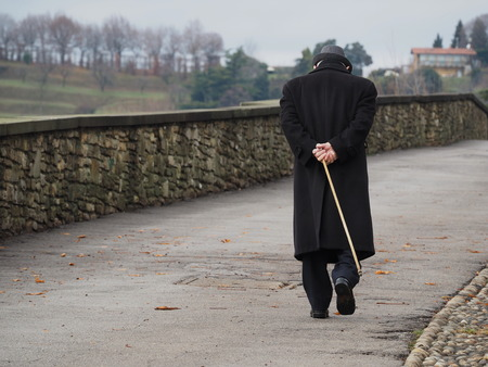 Old man walks along venetian walls, Bergamo