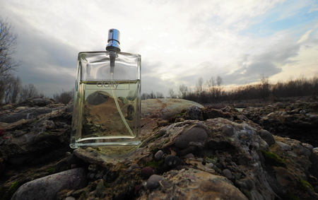 Perfume spray on the rock Stock Photo