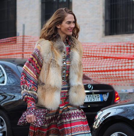 MILAN - January 13: Fashionable walking woman before NEIL BARRETT fashion show, during Milan Fashion Week FALL  WINTER 201819. January 13 2018 Milan, Italy. Sajtókép