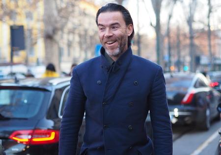 MILAN - January 13: Fashionable man walking man before NEIL BARRETT fashion show, during Milan Fashion Week FALL  WINTER 201819. January 13 2018 Milan, Italy.