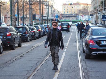 MILAN - January 13: Fashionabl man walking before NEIL BARRETT fashion show, during Milan Fashion Week FALL  WINTER 201819. January 13 2018 Milan, Italy.