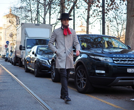 MILAN - January 13: A fashionable man walking before NEIL BARRETT fashion show, during Milan Fashion Week FALL  WINTER 201819. January 13 2018 Milan, Italy. Sajtókép