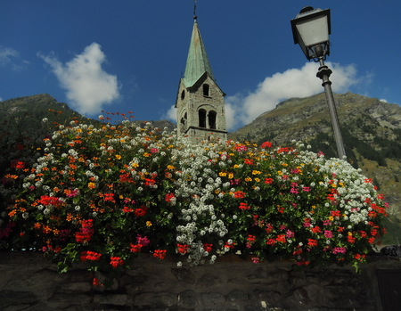 Floreal and bell tower from Gressoney, Aosta, Italy.