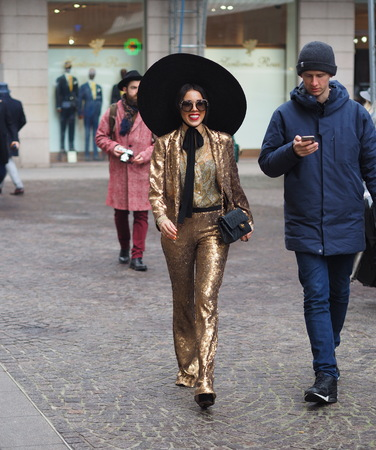 MILAN - FEBRUARY 22, 2018: Eccentric woman walking in the street before LES COPINS fashion show, during Milan Fashion Week Woman fall  winter 201819 on February 2018 in Milan, Italy.