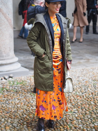 MILAN - FEBRUARY 22, 2018: Fashionable asian woman posing for photographers in