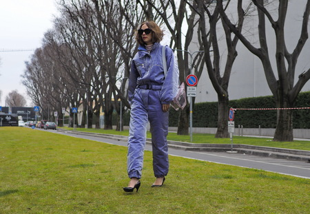 MILAN - FEBRUARY 25, 2018: Fashion blogger CANDELA PELIZZA posing for photographers in the street before Armani fashion show, during Milan Fashion Week Woman fall / winter 2018/19 in Milan, Italy.