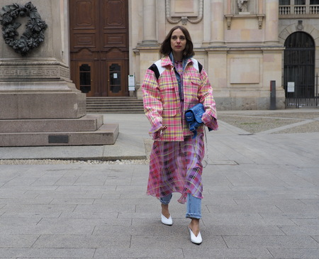 MILAN - FEBRUARY 25, 2018: Fashion blogger CANDELA PELIZZA posing for photographers in SAN FEDELE square before MSGM fashion show, during Milan Fashion Week Woman fall / winter 2018/19 in Milan, Italy.