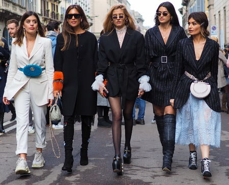 MILAN - FEBRUARY 24, 2018: Fashion bloggers walking for photographers in the street after ERMANNO SCERVINO fashion show, during Milan Fashion Week Woman fall / winter 2018/19 in Milan, Italy.