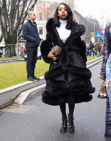 MILAN - FEBRUARY 25, 2018: Fashionable woman posing for photographers in the street before ARMANI fashion show, during Milan Fashion Week Woman fall  winter 201819 in Milan, Italy. Редакционное