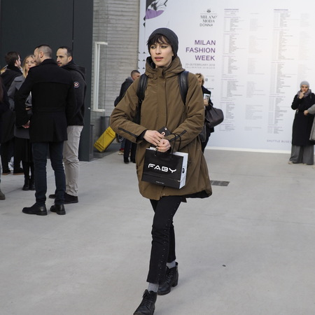 MILAN - FEBRUARY 24, 2018: Fashionable woman walking in the street for photographers before CIVIDINI fashion show, during Milan Fashion Week Woman fall  winter 201819 in Milan, Italy.