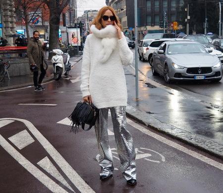 ilan, Italy - February 25, 2016: A fashionable woman walking in the street during Milan Fashion Week Women Fall  Winter 2016
