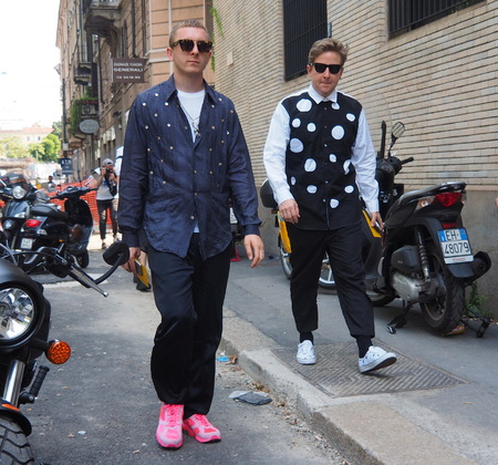 MILAN, ITALY -JUNE 16, 2018: Eccentric men walking in the street before NEIL BARRETT fashion show, during Milan Fashion Week Men and women spring collections