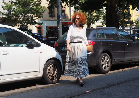 MILAN, ITALY -JUNE 16, 2018: Fashionable woman walking in the streets before Neil Barrett fashion show, during Milan Fashion Week Men and women spring collections Sajtókép