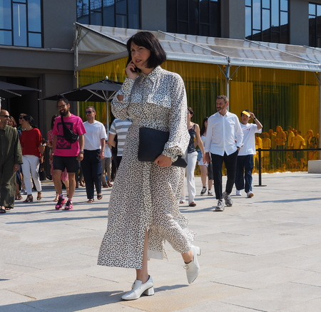 MILAN, ITALY -JUNE 16, 2018: Fashionable woman walking in the street after NEIL BARRETT fashion show, during Milan Fashion Week Men and women spring collections