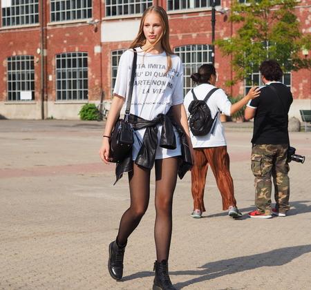 MILAN - SEPTEMBER 21: Olivia Mink posing for photogrphers after AQUILANO RIMONDI fashion show, during Milan Fashion Week spring / summer 2018 on September 21, 2017 in Milan.